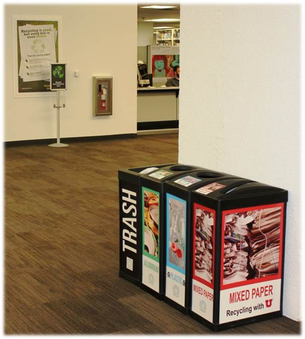 View of recycling quad and battery recycling in the Knowledge Commons, level two