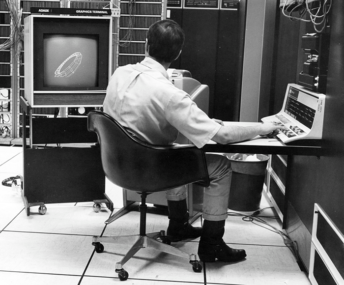 A unknown researcher creating computer graphics at the University of Utah. (c. 1970)