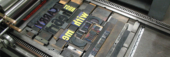 Woodtype locked up on one of the Book Arts Program Studio's Vandercook presses