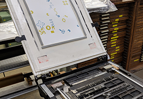 image of type and print on iron handpress