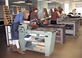 students using letterpress printing presses