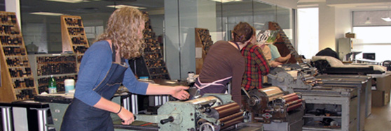 letterpress students running the vandercook presses