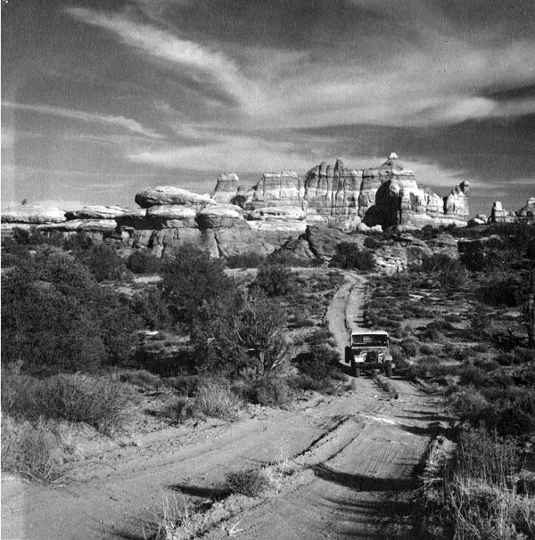 Jeep in Chelser Park, Canyonlands National Park.  1962.  Photograph by Earl T. Van Pelt