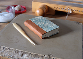 image of quarter leather bound book