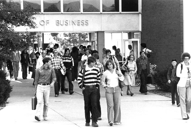 students walking in front of the business building